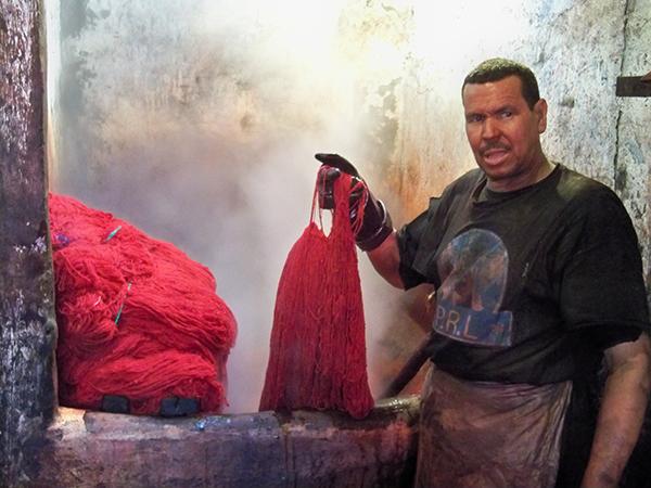 Man Dyeing Yarn