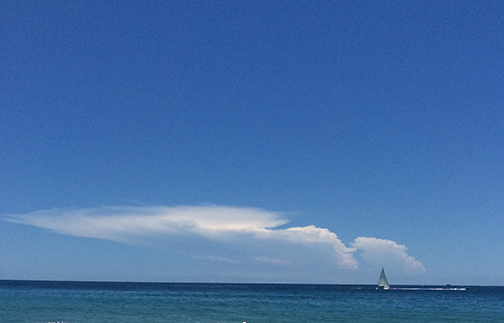 sail boat before the cloud