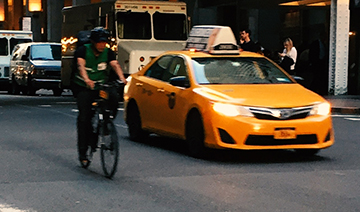 Yellow Taxi and bike